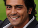 Arjun Rampal claims that he was complimenting Kareena Kapoor when he compared her to Sachin Tendulkar.