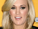 Carrie Underwood says that it was great having fiance Mike Fisher at the CMT Awards with her.