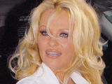 Pamela Anderson arrives for an appearance on the Larry King Show
