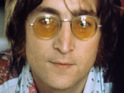 The suit that John Lennon wore on the cover of Abbey Road sells at auction.