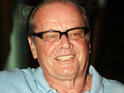 A Hollywood home owned by Jack Nicholson burns down, injuring two firemen.
