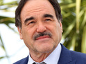 Oliver Stone misses a media appearance after being held at a Brazilian airport over visa issues.