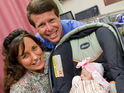Michelle and Jim Bob Duggar take their baby daughter Josie home from the hospital.