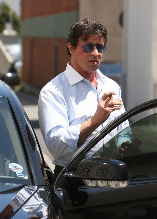 Sylvester Stallone smoking a cigarette (or weed)