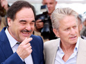 "Director Oliver Stone comments that Michael Douglas is still suffering from ""precarious"" health."