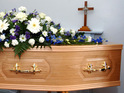 Mourners were paying last respects when they noticed movement in coffin.
