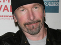 The Edge says that Bono is on the road to recovery after undergoing emergency back surgery.