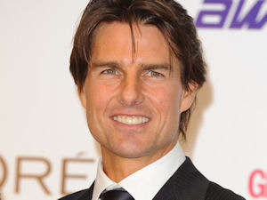 Tom Cruise with the 'Screen Icon' award he won at last night's National Movie Awards held in London