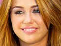 Miley Cyrus says that she is looking forward to the Travoltas' new addition.