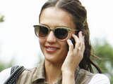Jessica Alba talking on her cell phone while arriving at a residence in Beverly Hills
