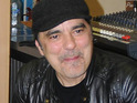 Producer Daniel Lanois is in intensive care after a serious motorcycle accident.