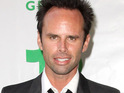 Walton Goggins says that he was changing his son's diaper when he heard he'd been nominated for an Emmy.