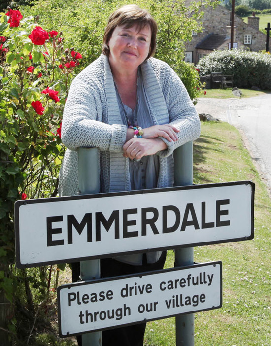 Pauline Quirke by the Emmerdale sign