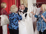 Ronnie and Roxy poke fun at the dated looking dresses. Eventually Ronnie agrees to try on some dresses.