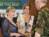 Carol, Whitney and Bianca arrive at the army recruitment office, demanding to know why Billie has refused his leave.