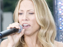 Sheryl Crow says that she tries to keep her kids out of the spotlight to give them a normal upbringing.