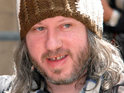 Singer Badly Drawn Boy shouts abuse at audience members during a performance in an LA club.