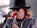 Axl Rose reportedly has a pint of beer thrown at him during their gig.