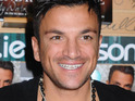 Peter Andre denies rumors that he is dating Kim Kardashian, but is happy to be linked with someone he finds attractive.