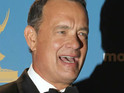 Tom Hanks recalls a recent meeting with Queen Elizabeth II and Barack Obama.