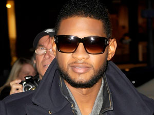 Usher attends a photocall to promote his OMG Tour 2011