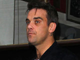 Robbie Williams leaves the BBC Radio 1 studios in London