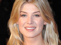 Rosamund Pike says that she likes men who have charisma and confidence instead of traditional good looks.