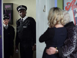 As Janine prepares to do a runner, she is horrified to open her front door to police officers.