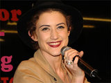 Ex-X Factor contestant Katie Waissel performs a Christmas sing-a-long at a Selfridges store in Manchester
