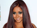 Jersey Shore star Snooki is to be dropped in a ball 'like a hamster' on New Year's Eve.