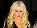 Christina Aguilera reportedly clashes with Burlesque co-star Julianne Hough at a Hollywood party.