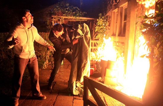 Andy and Carl shout for Katie as the fire is spreading quickly