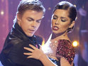 Derek Hough reportedly warns Cheryl Cole against reuniting with her ex-husband Ashley.