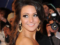 Michelle Keegan hints at troubled times ahead for Tina and Graeme in Coronation Street.