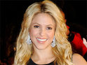 Shakira returns to Columbia to help build a school in a high risk area.