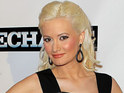 Holly Madison says that she still feels protective of ex-boyfriend Hugh Hefner.