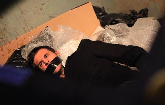 Nikhil Sharma (Rik Makarem) in a bin