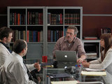 House: S07E14: House and the team discuss a case