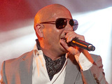 Rapper Pitbull performing on the Music Plaza stage during Mardi Gras