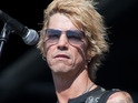 Guns N' Roses bassist says in newspaper column that talking to others helped him.