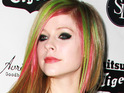 Avril Lavigne insists that she tried not to tether her emotions while recording her latest album.