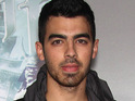 Joe Jonas reveals that talks of him joining Britney Spears's 'Femme Fatale' tour took place.