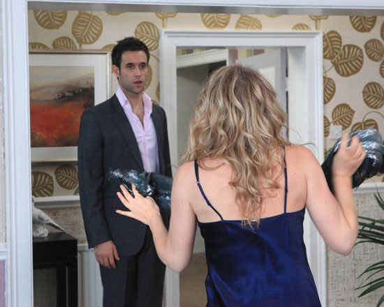 Charity is shocked when Nikhil comes home to find her in a revealing outfit
