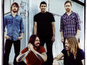 Foo Fighters reveal that they don't take notice of what is happening in the charts when writing.
