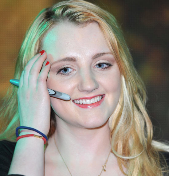Evanna clutches her autograph pen tightly.