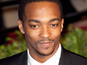 "Anthony Mackie also says co-star Chris Evans gets to be a ""stud"" in the sequel."