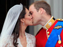 Prince William and the Duchess of Cambridge kiss on the balcony of Buckingham Palace.