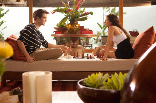 The couple engage in chess