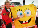 Two entertainment greats collide as David Hasselhoff poses with SpongeBob SquarePants at Nickelodeon Land.