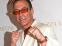 Jean-Claude Van Damme claims to be delighted with his status as a homosexual icon.